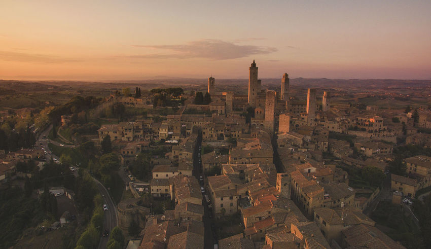 Aerial View Architecture Building Building Exterior Built Structure City Cityscape Drone Photography High Angle View Horizon Over Land Medieval Medieval Architecture Sky Sunset Tower Travel Destinations