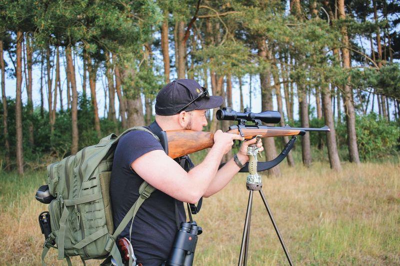 Deer Hunting Tree Land Leisure Activity Target Shooting Aiming Weapon Hunting Gun Real People Men Shooting A Weapon Hunter