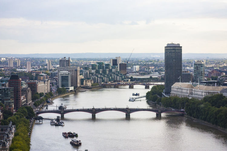Overhead view of London, England Architecture Bridge Bridge - Man Made Structure Building Exterior Built Structure City City Life Cityscape Cloudy Connection Day England London Modern No People Outdoors River Sky Skyscraper Thames Thames River Travel Destinations Urban Skyline Water Waterfront