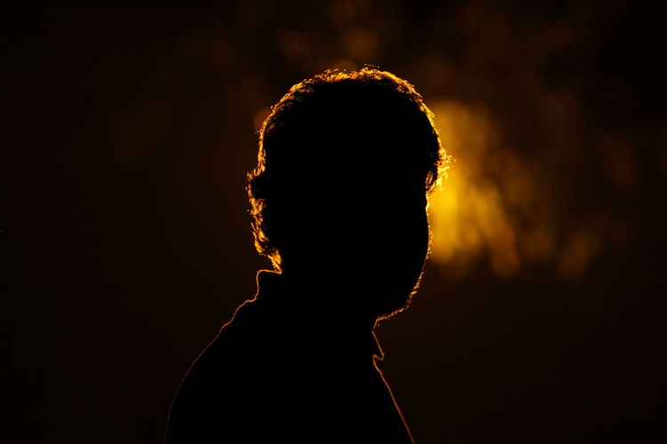 Close-Up Of Silhouette Person Against Black Background