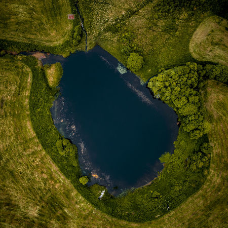 Top down lake. Aerial View Water Nature No People Green Color Environment Plant Grass High Angle View Tree Outdoors Land Golf Course Golf Landscape Scenics - Nature Directly Above Night Volcanic Crater Power In Nature
