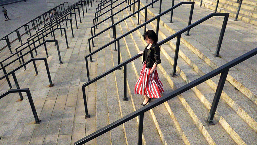 Woman walking on railing