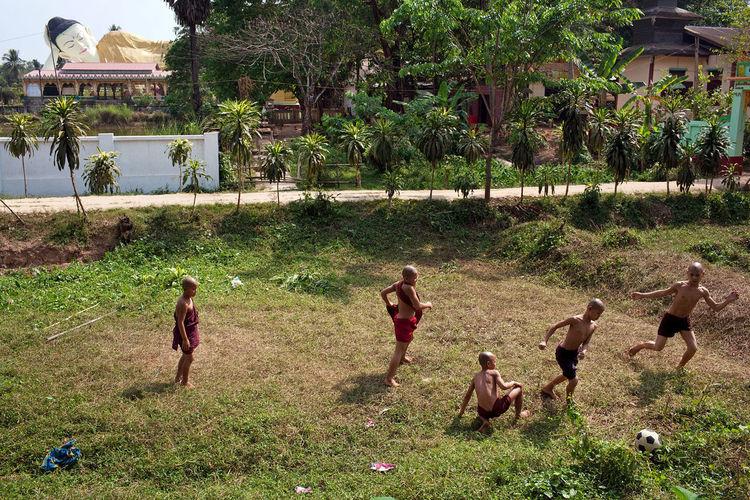 A football match outside a Buddhist monastery in Bago, Myanmar. March 2012. ASIA Myanmar Burma Bago Football Sport Match Monks The Street Photographer - 2017 EyeEm Awards
