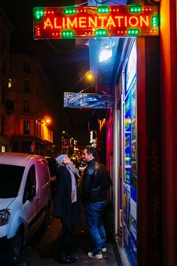 The couple Neon Couple Illuminated Architecture City Night Built Structure Building Exterior Street People The Street Photographer - 2018 EyeEm Awards