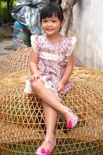Sweet smile of a little girl on a chicken coop People ASIA Asian  Girl Post Model Family Sisters Sister ❤ Family❤ Kids Thailand Chiken Doop Child Childhood Smiling Portrait Girls Happiness City Full Length Sitting Beauty Only Girls Eye Color Sundress Sleeveless Dress Mini Dress