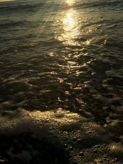 Insomnia Water Reflection Sunlight Nature No People Beauty In Nature Sea Outdoors Tranquility Backgrounds Beach Scenics Day Close-up EyeEmNewHere