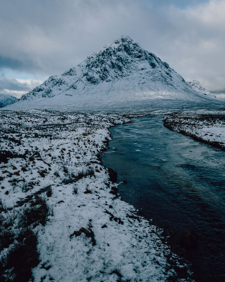 Winter snow mountain landscape in Glencoe, Scotland, UK Mountain Winter Snow Snowcapped Mountain Cold Temperature Glencoe Sky Clouds Moody Scotland Scottish Highlands Uk United Kingdom Ice Weather Nature
