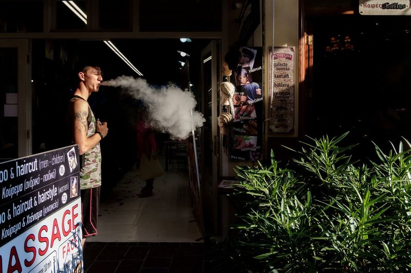 Puff! Smoke Smoking X-Pro1 Fujifilm X-Pro1 Streetphotography Street Photography Streethunters Street Hunters Real People Built_Structure Lifestyles One Person Leisure Activity Architecture Building Exterior Standing Adult Side View The Week On EyeEm Editor's Picks