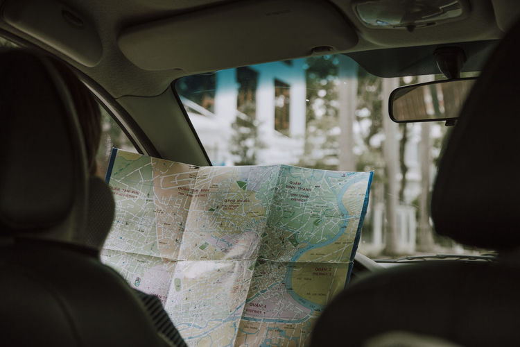 Person Holding Map In Car