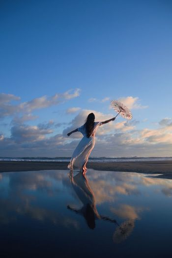 MIRAGE Water Reflection Sky One Person Full Length Beauty In Nature Standing Ballet Cloud - Sky Ballet Dancer Women Young Adult Scenics Young Women Nature Real People Outdoors Horizon Over Water Day Adult Sea And Sky Sea Ocean Beach Sommergefühle