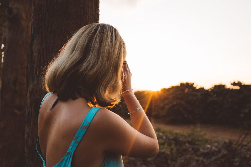 Golden hour EyeEm Selects Real People One Person Women Leisure Activity Lifestyles Rear View Nature Sunlight Sky Sunset Girls Hair Hairstyle Plant Outdoors