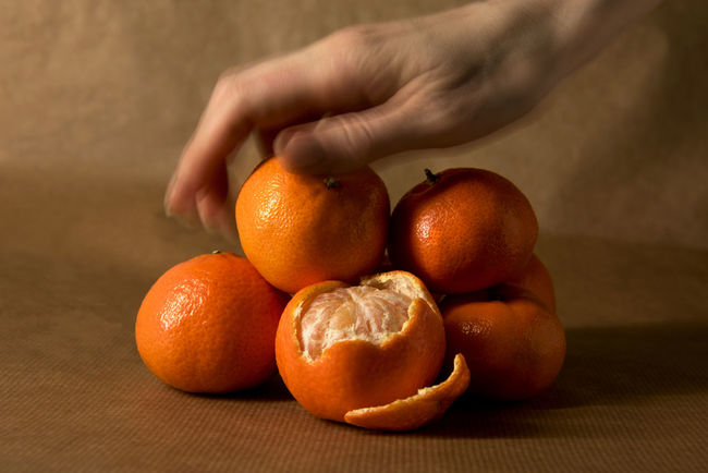 A hand grabbing a clementine from a pile Citrus  Freshness Snack Body Part Brown Brown Paper Citrus Fruit Clementine Clementines Food Fruit Grabbing Hand Healthy Healthy Food Ingredient Mandarins Monochromatic Monochrome Mood Obst Orange Color Peel Peeling Pile Still Life