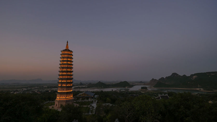 Dinh Pagoda complex in late evening with illuminated high tower temple. Sightseeing of Vietnam Architecture ASIA Buddhism Building City Culture Dusk Evening History Horizontal Nature Orient Outdoors Religion Sight Temple Tourism Tower Travel Vietnam