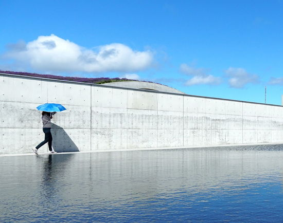 Architecture Bright Cemetery Hot Makomanai Takino Reflection Tadao Ando Wall Water And Sky Water Reflections Adult Blue Blue Umbrella Cloud - Sky Light And Shadow One Person Outdoors Real People Reflections In The Water Side View Sky Sunny Day Umbrella Walking Water