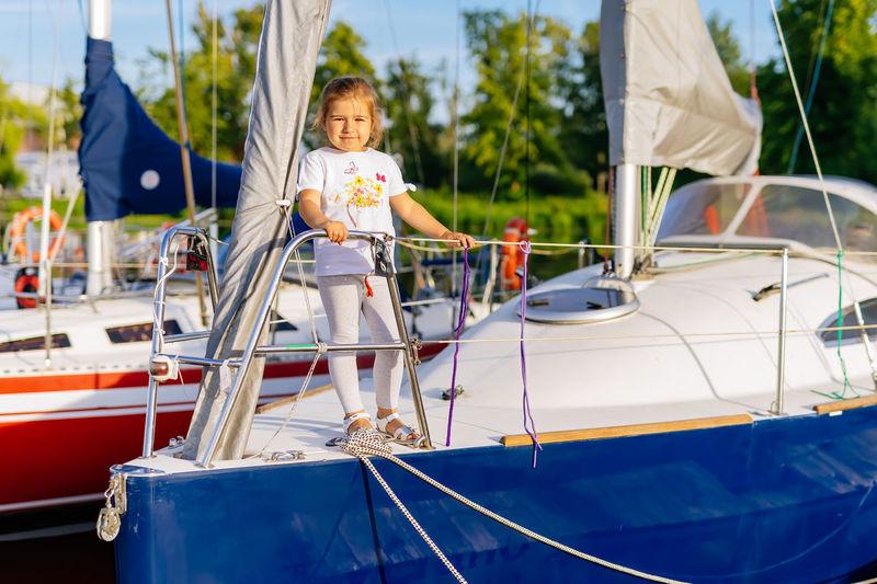High angle view of boy on sailboat