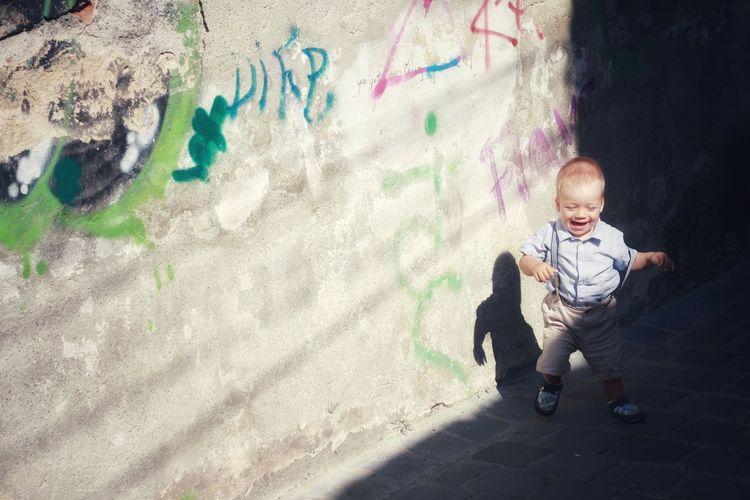 Full length portrait of happy boy