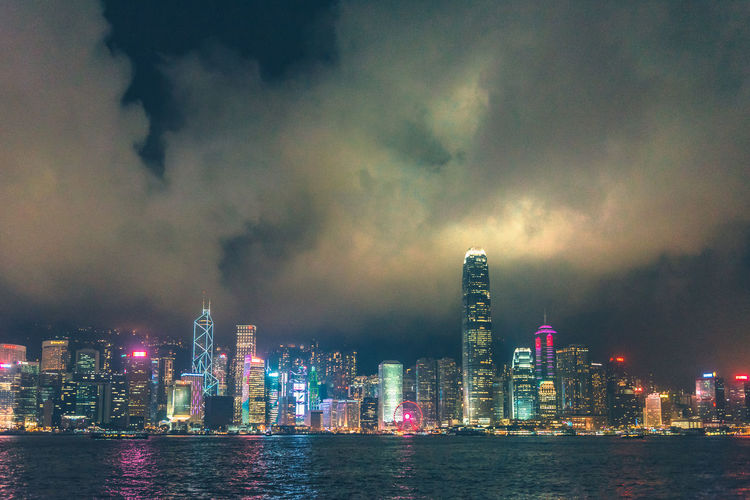 Night lights from skyscraper buildings landmark at Victoria harbor in Hong Kong Architecture ASIA Asian  Bay Beautiful Boat Building Business City Cityscape Colorful Downtown Evening Finance Harbor Harbour Hong Kong HongKong Island Kowloon Landmark Laser Light Lights Modern Night Panorama Sailboat Scene Sky Skyline Skyscraper Symphony Tourist Tower Travel Victoria View Water Building Exterior Built Structure Cloud - Sky Urban Skyline Waterfront Nature Landscape Tall - High No People Outdoors Financial District