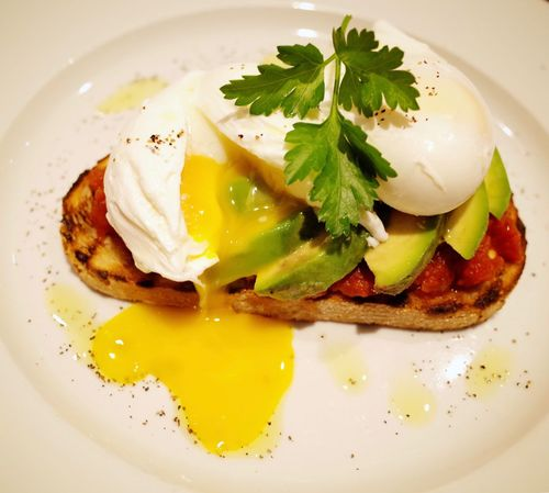 Avocado toast with runny poached eggs Nobody Plate Messy Runny Eggs Poached Eggs  Avocado Toast  Breakfast Plate Food And Drink Food Indoors  Close-up Egg Freshness Ready-to-eat No People Serving Size Indulgence Fried Egg Poached Egg Yolk