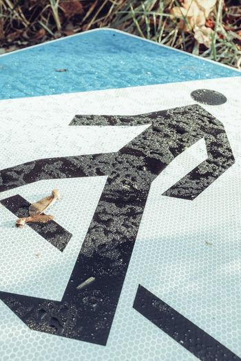 High angle view of arrow sign on swimming pool