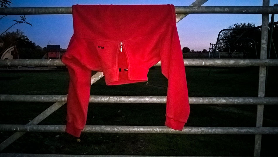 Abstract Clothing Dusk Flash Gate Hanging Hung Jacket Outdoors Railing Red Sky