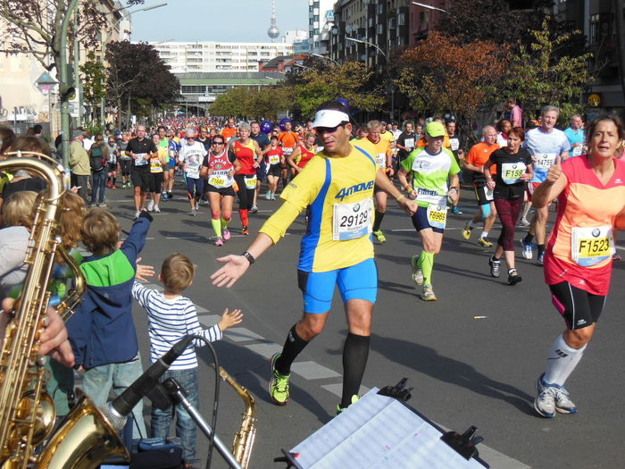 Reaching out for a hand at the Kottbuser Damm during the Berlin Marathon, the traditional sportsevent in september. Berlin Marathon Crowd Large Group Of People Outdoors Sport Streetlife Togetherness Walking