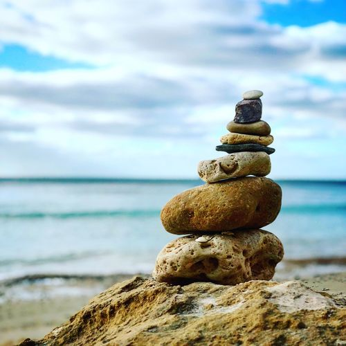 Balance Sea Stack Sky Water Rock - Object Nature Focus On Foreground Cloud - Sky No People Balance Outdoors Day Beauty In Nature Tranquility Beach Scenics Horizon Over Water Close-up