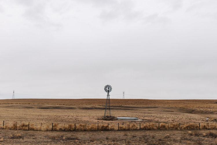 Water pump windmill on field