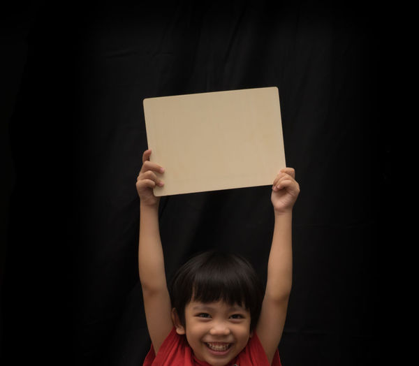 Copy Space Black Background Blank Boy Child Childhood Children Only Close-up Day Front View Girls Headshot Holding Human Body Part Indoors  Looking At Camera One Person People Portrait Smiling Standing
