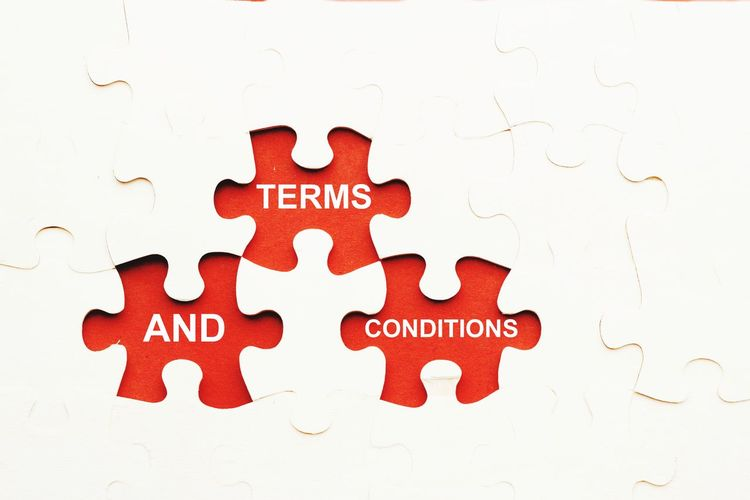 Terms and conditions concept Puzzle  Puzzles Terms And Conditions Isolated White Background Isolated Rules Concept Conceptual Text Words Regulation Concept Red Text Close-up Alphabet Information