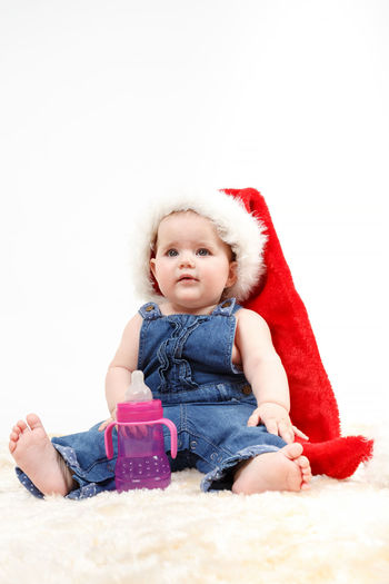 Cute baby girl over white background