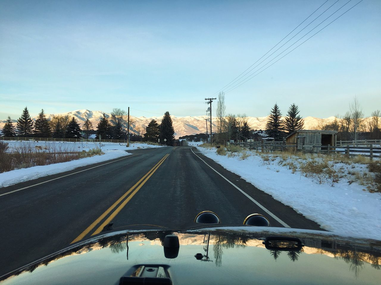 transportation, snow, winter, cold temperature, mode of transportation, car, sky, land vehicle, tree, road, windshield, motor vehicle, plant, glass - material, vehicle interior, nature, no people, transparent, covering, diminishing perspective, car point of view
