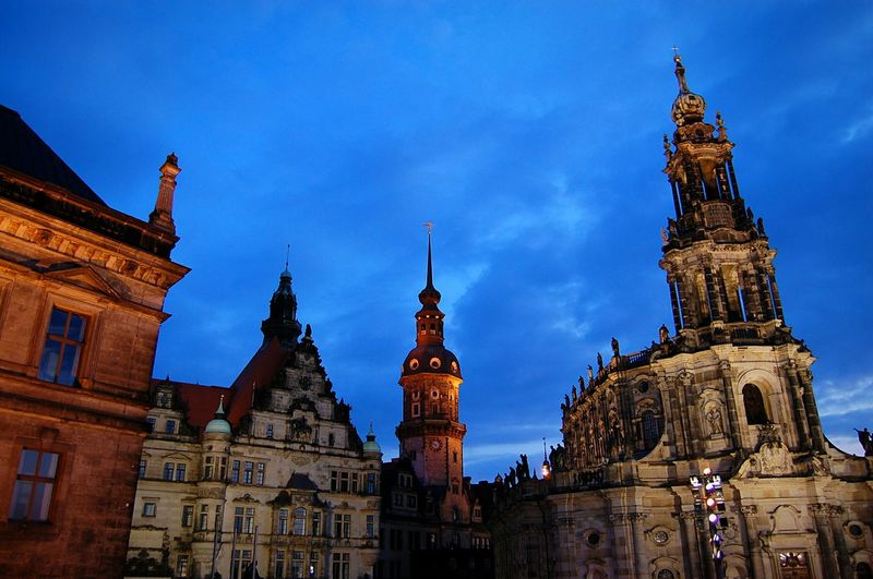 Low angle view of dresden cathedral against cloudy sky at dusk