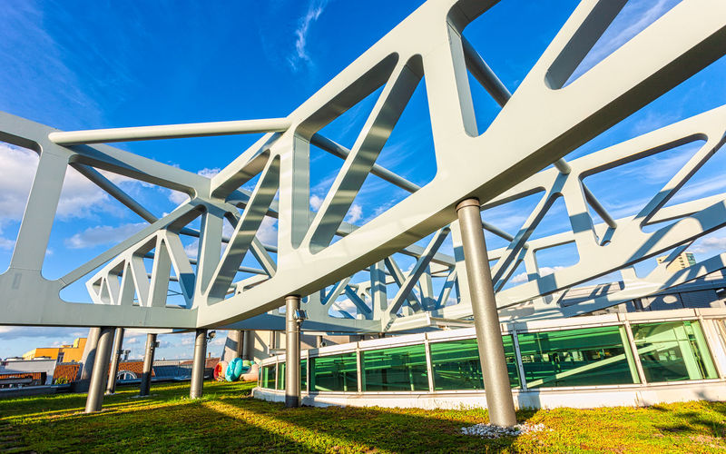 High Tech Roof Construction Roof Rooftop Stilwerk Architecture Blue Building Exterior Built Structure Day Grass Large Construction Low Angle View Metal Modern No People Outdoors Sky Sunlight Support Structure Top Of Building