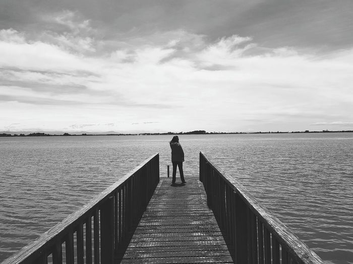 One Person Pier Water Sea One Woman Only Horizon Over Water Discovery Nature Outdoors New Zeland  Redcliffs Estuary View Beauty In Nature Tranquility Nature Coastal Views Tranquil Scene Contrasting Colors Black & White Black & White Photography