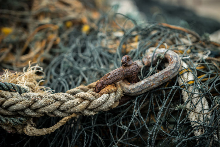Close-Up Of Rope Tied To Fishing Net