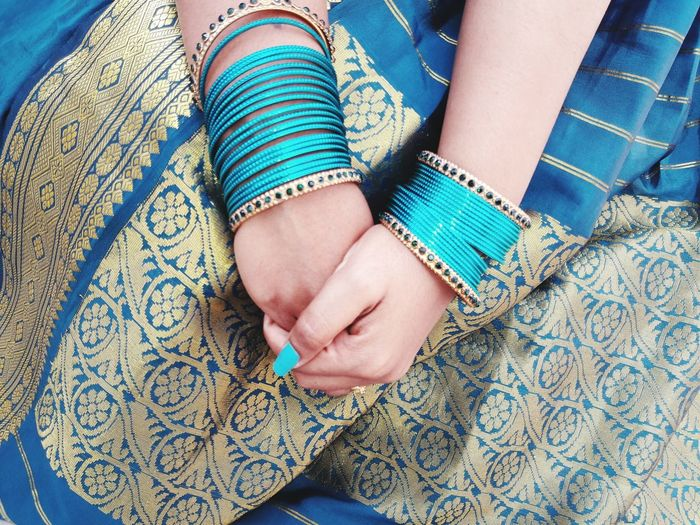 Midsection Of Woman In Blue Sari And Bangles
