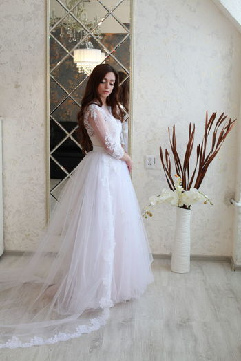 Wedding Bride Newlywed Celebration Event Real People Women Wedding Dress One Person Lifestyles Life Events Young Adult Adult Standing Young Women Clothing White Color Full Length Leisure Activity Fashion Beautiful Woman Flower Arrangement Bouquet