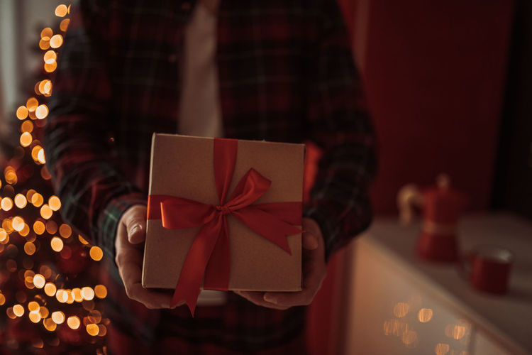 Man holding christmas decoration in box