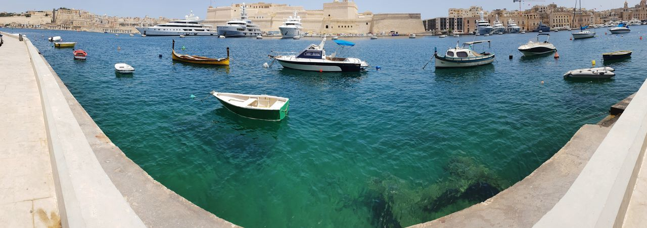 find your boat Malta♥ Maltaphotography Boats⛵️ Explorer Locals Summer Picoftheday Curious Malta In My Eyes #travelphotography Summertime #panorama #colours #pictures #beautiful Panoramic Panoramic Photography Waterfront EyeEm Selects Water Nautical Vessel Harbor Yacht Sea City High Angle View Architecture Building Exterior