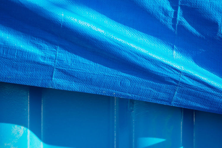 Blue No People Day Full Frame Close-up Pattern Indoors  Architecture Built Structure Textile Backgrounds Sunlight Textured  Reflection Security Low Angle View Protection Wall - Building Feature Safety Corrugated Turquoise Colored Container Wrapped