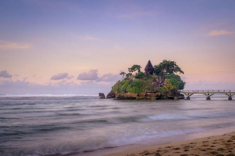 Morning view of pura amerta jati temple on the ismoyo island, at balekambang beach, indonesia.