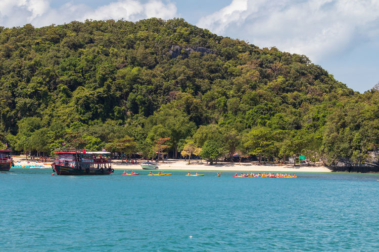 Angthong National Marine Park Thailand Beauty In Nature Day Green Color Growth Mode Of Transportation Mountain Nature Nautical Vessel Outdoors Passenger Craft Plant Samui_thailand Scenics - Nature Sea Sky Tranquil Scene Tranquility Transportation Travel Tree Turquoise Colored Water Waterfront
