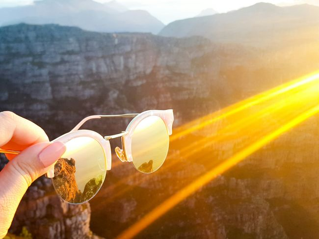 Last sunset of 2016 One Person Sunlight Nature Holding Close-up Mountain People Outdoors Day Mountain_collection Mountains Sunset Sky Mountain Range Table Mountain Cape Town Sunlight Sunglasses Reflection Reflection_collection Pink Pretty Style Beauty Mirror