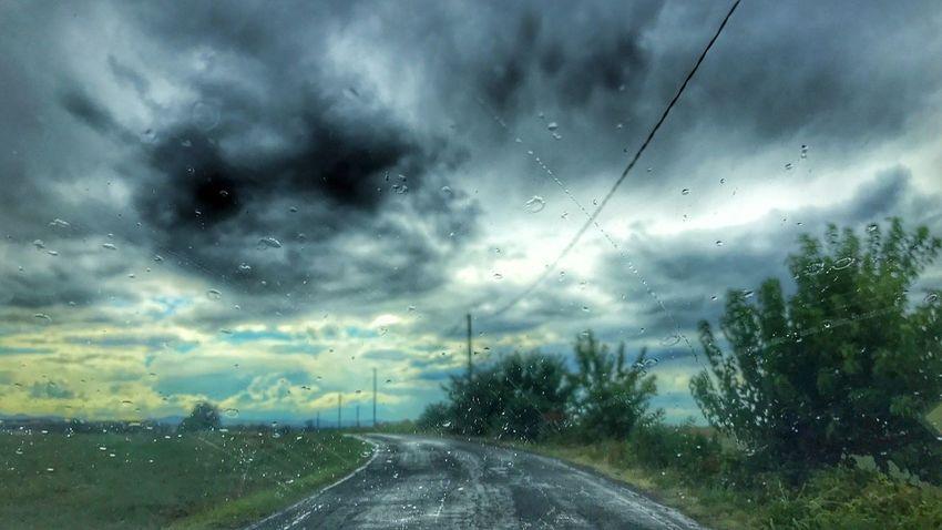 Rain Weather The Way Forward Road Windshield Drop Wet Rainy Season Cloud - Sky No People RainDrop Transportation Nature Sky Day Car Car Interior Storm Cloud Outdoors Water