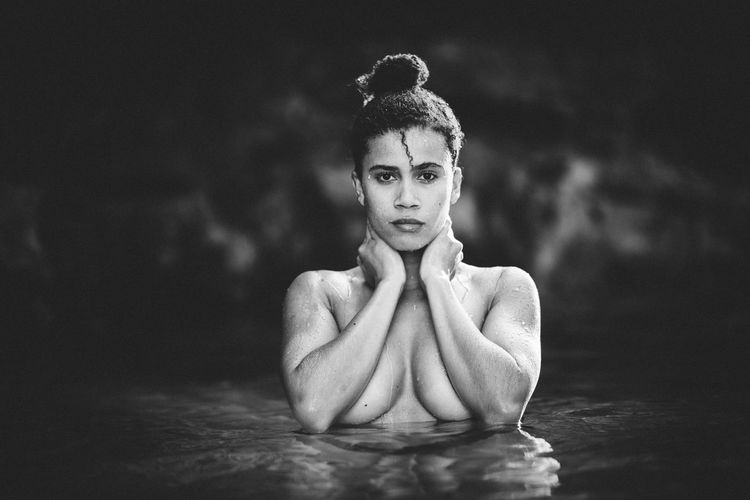 Portrait Of Shirtless Woman Standing In Sea