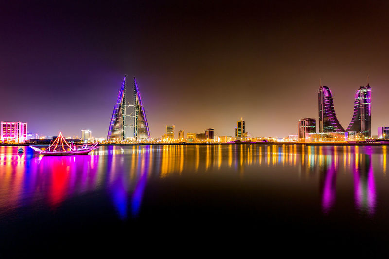 Beautiful and wide view of the Seafront with illuminated World Trade Center and other high rise buildings in the city, Manama, Bahrain Architecture Bahrain Bridge - Man Made Structure Building Exterior City Cityscape Cultures Ferris Wheel Illuminated Modern Neon Night No People Outdoors Reflection River Sky Skyscraper Tourism Travel Travel Destinations Urban Skyline Water World Trade Center Wtc, First Eyeem Photo