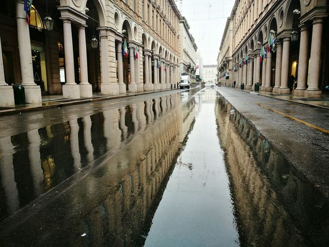 Architecture Reflection Water Puddle Built Structure Day Architectural Column City Flood Building Exterior No People Outdoors EyeEm Selects Torino Riflessosullacqua Riflessi Riflesso D'acqua Riflesso The Week On EyeEm Centro Central Streetphotography Strett Architettura Viaroma