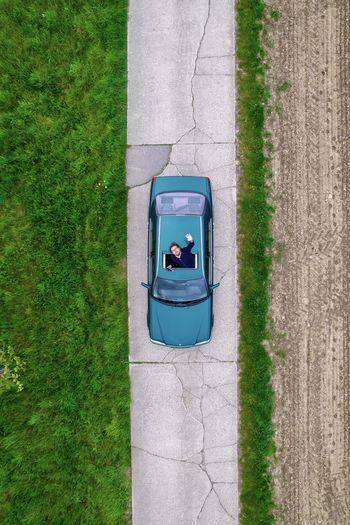 Top view of mercedes car in farmland