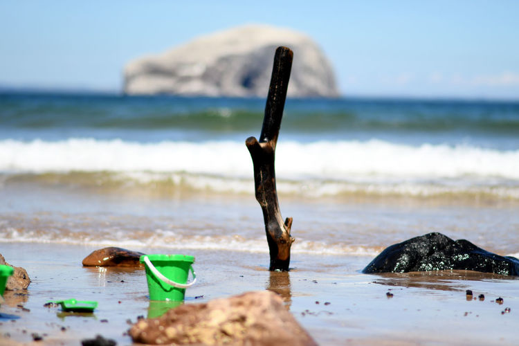 Bass Rock Aquatic Sport Beach Beachwood Beauty In Nature Bucket Day Horizon Over Water Land Motion Nature No People Outdoors Pollution Rock Rock - Object Sand Sea Seacliff Selective Focus Sky Sport Tranquility Water Wave