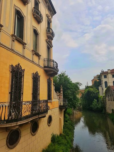 EyeEmNewHere Architecture Building Exterior Outdoors Water Italy Cloud - Sky Padova, Italy CityWalk Walking Around Greenery Architecture Reflection Balcony Built Structure Special Culture And Buildings Travel Destinations Streetphoto Springtime EyeEmNewHere EyeEmNewHere The Architect - 2017 EyeEm Awards